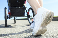 Shoes jogging baby cart Stock Photos