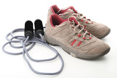 Shoes and jump rope Stock Images