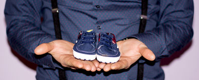 Shoes. Kid, pregnant, photos, blue royalty free stock photo