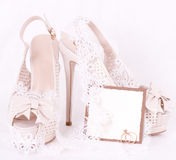 Shoes, lace and wedding rings Royalty Free Stock Photo