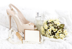 Shoes, lace and wedding rings with banner add. The beautiful bridal shoes, lace and wedding rings with banner add Royalty Free Stock Photo