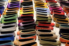 Shoes. A large and colorful selection of ladies shoes (flats) positioned in four even rows Stock Photography