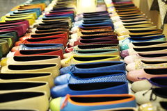 Shoes 2. A large and colorful selection of ladies shoes (flats) positioned in four even rows Stock Photo