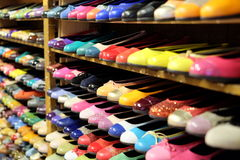 Shoes 3. A large and colorful selection of ladies shoes (flats) positioned on the wall shelves Stock Photography