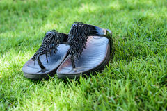 Shoes lay on the grass Royalty Free Stock Image