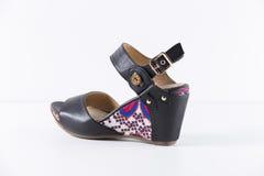 Shoes leather. Beautiful Elegance and Luxury Leather Black Femme sandal on White Background Royalty Free Stock Photography