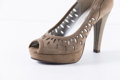Shoes leather. Beautiful Elegance and Luxury Leather Brown Femme shoe on White Background Stock Photography