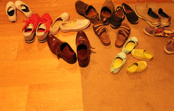 Shoes Left at the Door. Pairs of shoes left at the door while people attend a party Royalty Free Stock Images