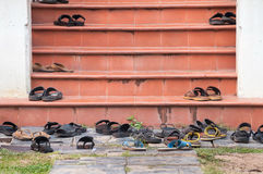 Shoes left on temple steps, Thailand Stock Image