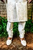 Shoes and legs of an Asian groom in a White traditional Indian groom stock photos