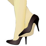 Shoes and legs of a woman Royalty Free Stock Photography