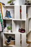Shoes lie on a shelf  in a designer store Royalty Free Stock Photo