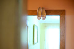 Shoes on Lintel Royalty Free Stock Photos