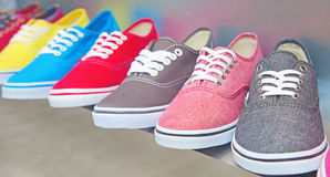 Shoes. Lots of sneaker shoes on sale Stock Images