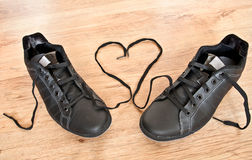 Shoes of love. Pair of runners with heart shape Royalty Free Stock Images