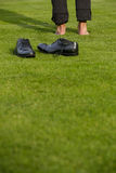 Shoes and low section of a man Royalty Free Stock Image