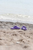 The shoes lying on the pebble beach Stock Images