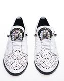 Shoes made out of white leather on white background, isolated. Footwear for women on flat sole with perforation and. Rhinestones. Pair of fashionable Stock Images
