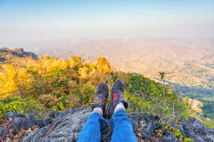 Shoes of a man on mountain Stock Photography