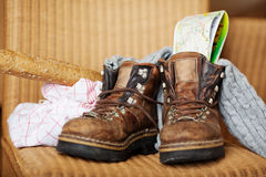 Shoes; Map And Breadloaf With Clothes On Chair Royalty Free Stock Photo