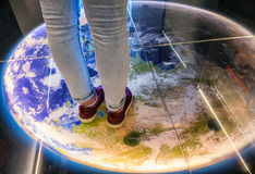 Shoes on the map. Walking on globe - planet earth. Shoes on the map Royalty Free Stock Photo