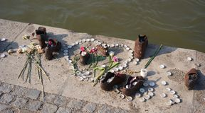 Shoes memorial, Budapest. Shoes memorial with candles and flowers to the memory of murdered Jews in the World War II Stock Photography