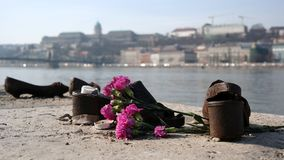 Shoes Memorial. On the Danube Bank in Budapest to commemorate the murdered Jews during The World War II with view of Buda castle in background Stock Image