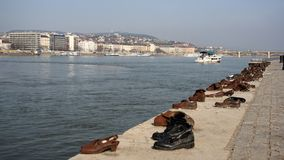 Shoes memorial on embankment in Budapest. Sixty pairs of shoes like memorial on the Danube Bank in Budapest to commemorate the murdered Jews during The World War Stock Images