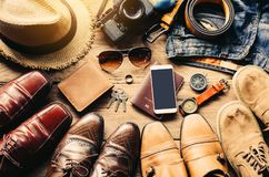 Shoes for men various styles and Travel accessories costumes. Pa Royalty Free Stock Images