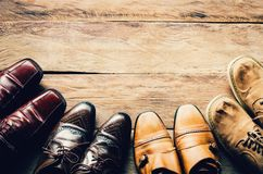 Shoes for men various styles on a wooden floor - lifestyles. Stock Photo