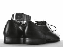 Shoes for men & Watches Royalty Free Stock Photos
