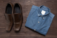 Shoes and menswear are on the wooden background.  Royalty Free Stock Photo