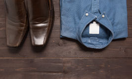 Shoes and menswear are on the wooden background.  Royalty Free Stock Images