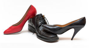 Shoes metaphor. Women on top, domination metaphor Royalty Free Stock Photo