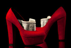 Shoes and money Stock Photos
