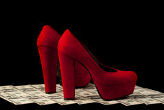 Shoes and money Royalty Free Stock Photography