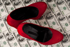 Shoes and money Stock Images