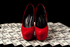Shoes and money Stock Photography