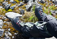 Shoes for mountain trekking on foot tourist. Stock Photo