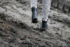 Shoes in the mud. Photo in motion. The concept of provincialism royalty free stock images