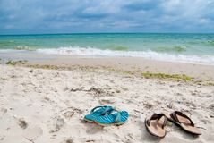 Shoes near sea Royalty Free Stock Images