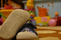 The shoes, the number, the toys, the child Stock Photo