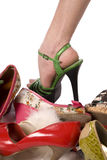 Shoes and one foot Stock Photography