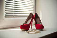 Shoes and ornaments. Royalty Free Stock Images