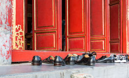 Shoes outside of a Buddhist Temple Royalty Free Stock Image