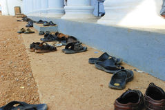 Shoes outside a Hindu Temple. Shoes outside a Hindu temple in Kerala, India Stock Photos