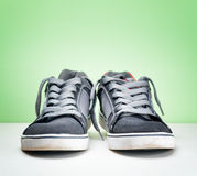 Pair of grey sneakers on colorful background Stock Images