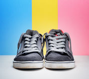 Pair of grey sneakers on colorful background Royalty Free Stock Images