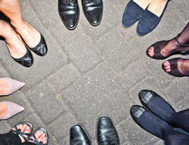 Shoes of party people standing Stock Photography