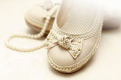 Shoes and pearls Royalty Free Stock Image